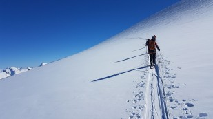 Roped up on the glacier and climbing towards the summit block
